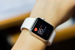 Apple smartwatch showing heartbeat rate on screen