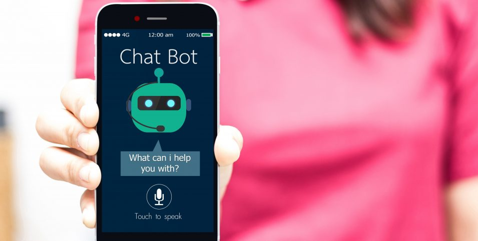 woman holding smart phone with chatbot on screen