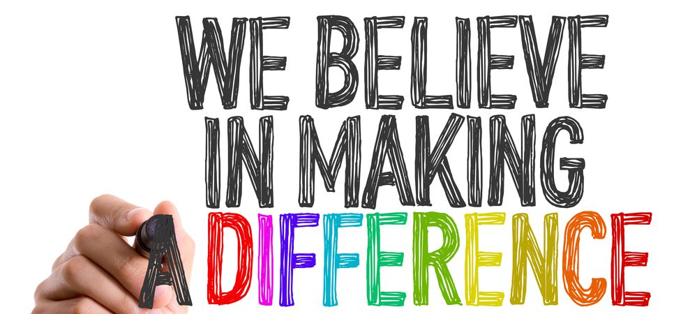 """Hand drawn sign that reads """"We believe in making a difference"""""""